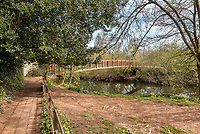 BNPS.co.uk (01202) 558833. <br /> Pic: Stags/BNPS<br /> <br /> Pictured: There is a public footpath that crosses an iron footbridge leading to the property and a private ford, which is passable by four-wheel drive in the summer.<br /> <br /> Pictured: Station Halt was the station for Brampford Speke in Devon on the Exe Valley Railway line until it closed as part of the Beeching cuts in 1963.<br /> <br /> Just the ticket...<br /> <br /> A converted railway station with an old train carriage in the garden - on the market for offers over £550,000 - is the perfect home for train enthusiasts.<br /> <br /> Station Halt was the station for Brampford Speke in Devon on the Exe Valley Railway line until it closed as part of the Beeching cuts in 1963.<br /> <br /> The 136-year-old building was converted shortly after and is now a pretty three-bedroom bungalow with original features including the waiting room fireplace, ticket office window and the old train platform.<br /> <br /> There is even an old train carriage in the 6.2-acre gardens that could be converted and earn income as a holiday rental.
