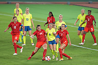 YOKOHAMA, JAPAN - AUGUST 6: Kosovare Asllani #9 of Sweden battles for the ball with Vanessa Gilles #14 ad Julia Grosso #7 of Canada during a game between Canada and Sweden at International Stadium Yokohama on August 6, 2021 in Yokohama, Japan.