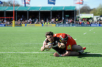Marcelo Bosch of Saracens scores a try early in the second half despite the efforts of Marcos Ayerza of Leicester Tigers who was injured in the process during the Aviva Premiership Rugby match between Saracens and Leicester Tigers at Allianz Park on Saturday 11th April 2015 (Photo by Rob Munro)
