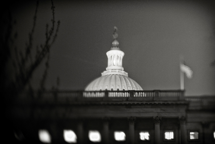 The United States Capitol at night  in Washington.