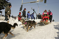 March 3, 2007   Spectators watch 5-time Iditarod champion Rick Swenson as he travels down the Cordova Hill during the Iditarod ceremonial start day in Anchorage