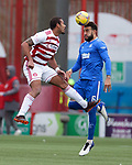 07.02.2021 Hamilton v Rangers: Connor Goldson heads clear from Marios Ogkmpoe