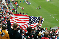 Fans hold up a flag before the start of the USA England match at Soldier Field, Friday, May 28, 2004, in Chicago, IL. England won 2-1.