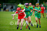 Niamh Leen of Kerry applies the pressure to Cork's Lorraine Collins in the Munster Junior Camogie semi final.