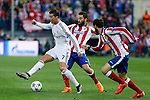 Atletico de Madrid's Arda Turan and Real Madrid´s Cristiano Ronaldo (L) during quarterfinal first leg Champions League soccer match at Vicente Calderon stadium in Madrid, Spain. April 14, 2015. (ALTERPHOTOS/Victor Blanco)