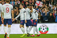 Callum Hudson-Odoi (Chelsea) of England (right) is congratulated after England's fifth goal during the UEFA 2020 Euro Qualifier match between England and Czech Republic at Wembley Stadium, London, England on 22 March 2019. Photo by David Horn.