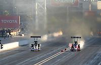Nov 2, 2019; Las Vegas, NV, USA; NHRA top fuel driver Richie Crampton (left) races alongside Doug Kalitta during qualifying for the Dodge Nationals at The Strip at Las Vegas Motor Speedway. Mandatory Credit: Mark J. Rebilas-USA TODAY Sports
