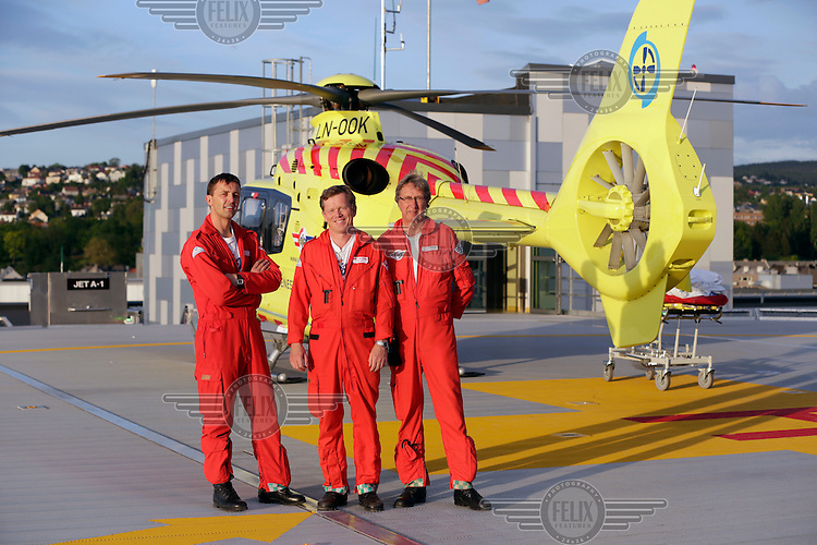 Doctor Steinar Einvik, pilot Viggo Jess Iversen and rescue paramedic Asbjørn Møller. Norwegian Air Ambulance operating EC 135 helicopter out of their base in Trondheim, one of eight bases operated by the company.