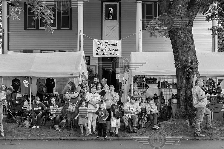 Spectators line the street at the Cranberry Festival Parade.