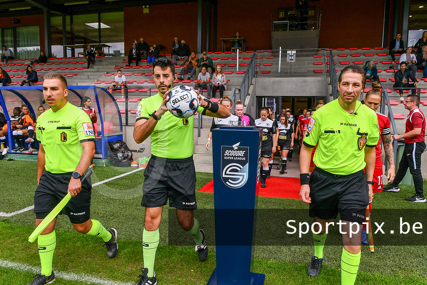 Assistant referees Nicolas Picman, Mostapha Chakouath, match referee Federico Baptiste (with the ball) pictured entering the pitch before a female soccer game between Standard Femina de Liege and Eendracht Aalst dames on the fourth matchday in the 2021 - 2022 season of the Belgian Scooore Womens Super League , Saturday 11 th of September 2021  in Angleur , Belgium . PHOTO SPORTPIX | BERNARD GILLET