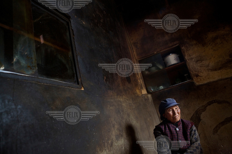 A woman in her home in the traditional Nakhi (Naxi) town of Lu Dian on the outskirts of Lijiang county.