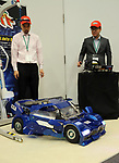 "November 21, 2017, Tokyo, Japan - Japanese robot creators Wataru Yoshizaki (R) of Asratec and Kenji Ishida (L) of Brave Robotics display the transformable robot ""J-deite Quarter"" which can change its shape of a robot to a vehicle at the ""Softbank Robot World 2017"" in Tokyo on Tuesday, November 21, 2017. Softbank's subsidiary Asratec and Brave Robotics have plan to launch a 4m tall transformable human ride robot ""J-deite RIDE"".     (Photo by Yoshio Tsunoda/AFLO) LWX -ytd-"