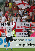 England captain David Beckham acknowledges flag waving fans after the match. England defeated Trinidad & Tobago 2-0 in their FIFA World Cup group B match at Franken-Stadion, Nuremberg, Germany, June 15 2006.