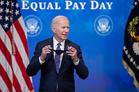 US President Joe Biden responds to a question from the news media following an event to mark Equal Pay Day in the State Dining Room of the White House in Washington, DC, USA, 24 March 2021. Equal Pay Day marks the extra time it takes an average woman in the United States to earn the same pay that their male counterparts made the previous calendar year.<br /> CAP/MPI/RS<br /> ©RS/MPI/Capital Pictures