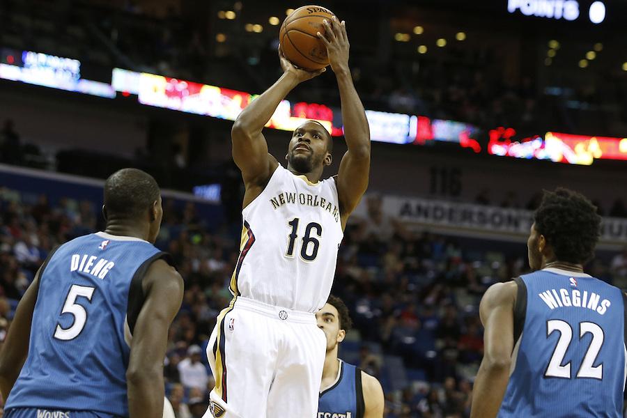 New Orleans Pelicans guard Toney Douglas (16) shoots over Minnesota Timberwolves center Gorgui Dieng (5) and guard Andrew Wiggins (22) during the first half of an NBA basketball game Saturday, Feb. 27, 2016, in New Orleans. (AP Photo/Jonathan Bachman)
