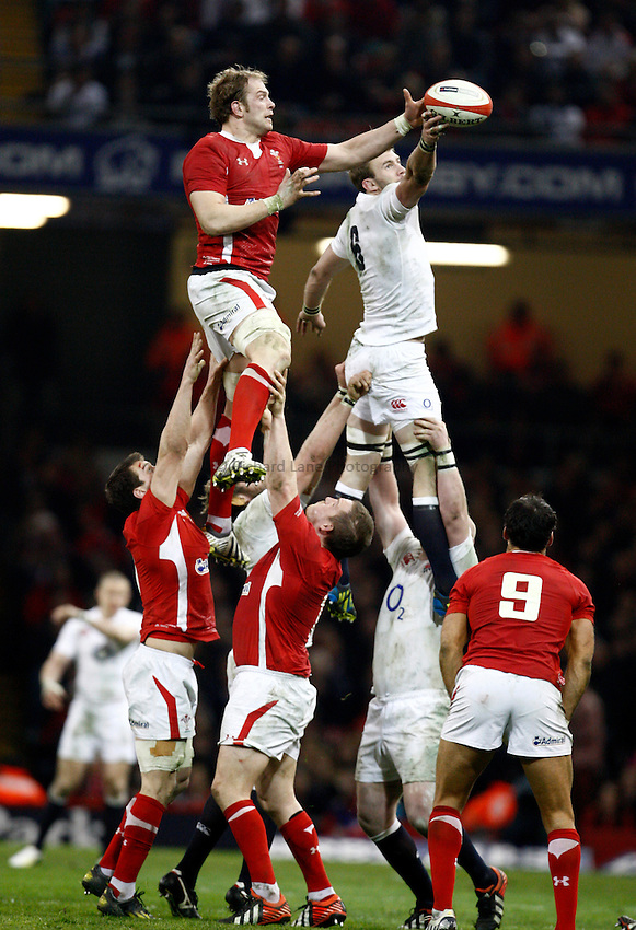 Photo: Richard Lane/Richard Lane Photography. Wales v England. RBS 6 Nations Championship. 16/03/2013. England's Tom Croft steals a lineout from Wales' Alun Wyn Jones.
