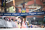 © Joel Goodman - 07973 332324 . 22/05/2016 . Manchester , UK . Men's winner KENENISA BEKELE at the finish . The Great Manchester Run in Manchester City Centre . Photo credit : Joel Goodman