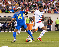 PHILADELPHIA, PA - JUNE 30: Kenji Gorre #14 and Weston Mckennie #8 battle for the ball during a game between Curaçao and USMNT at Lincoln Financial Field on June 30, 2019 in Philadelphia, Pennsylvania.