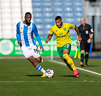 12th September 2020 The John Smiths Stadium, Huddersfield, Yorkshire, England; English Championship Football, Huddersfield Town versus Norwich City;  Onel Hernandez of Norwich City tracked by Isaac Mbenza of Huddersfield Town