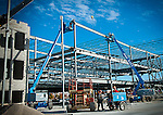 Construction site photo showing steel framing for building by steelworkers
