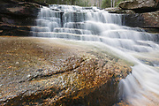 Fletcher Cascades on Drakes Brook in Waterville Valley, New Hampshire during the spring months.