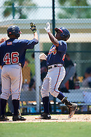 GCL Braves shortstop Nicholas Shumpert (92) high fives Randy Ventura (46) after hitting a home run during a game against the GCL Pirates on August 10, 2016 at Pirate City in Bradenton, Florida.  GCL Braves defeated the GCL Pirates 5-1.  (Mike Janes/Four Seam Images)