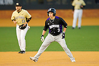 Trevor Stevens #3 of the Northwestern Wildcats takes his lead off of second base against the Wake Forest Demon Deacons at Gene Hooks Field on February 26, 2011 in Winston-Salem, North Carolina.  Photo by Brian Westerholt / Four Seam Images