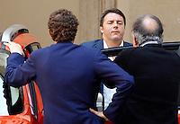 Il Presidente del Consiglio Matteo Renzi, al centro, con l'amministratore delegato della Fiat Sergio Marchionne, a destra, ed il presidente John Elkann, durante la presentazione della nuova autovettura Jeep Renegade, a Palazzo Chigi, Roma, 25 luglio 2014.<br /> Italian Premier Matteo Renzi, center, Fiat CEO Sergio Marchionne, right, and chairman John Elkann, attend the presentation of the new Jeep Renegade model car, at Chigi Palace, Rome, 25 July 2014.<br /> UPDATE IMAGES PRESS/Riccardo De Luca