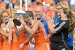 The Hague, Netherlands, June 14: Kim Lammers #23 of The Netherlands drinks champagne out of the World Cup Trophy after the field hockey gold medal match (Women) between Australia and The Netherlands on June 14, 2014 during the World Cup 2014 at Kyocera Stadium in The Hague, Netherlands. Final score 2-0 (2-0)  (Photo by Dirk Markgraf / www.265-images.com) *** Local caption ***