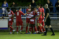 Emerson Dju of Ilford scores the first goal for his team and celebrates with his team mates during Redbridge vs Ilford, Essex Senior League Football at Oakside Stadium on 15th October 2021