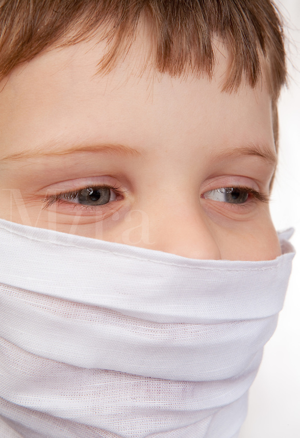 Little Boy with white medical mask