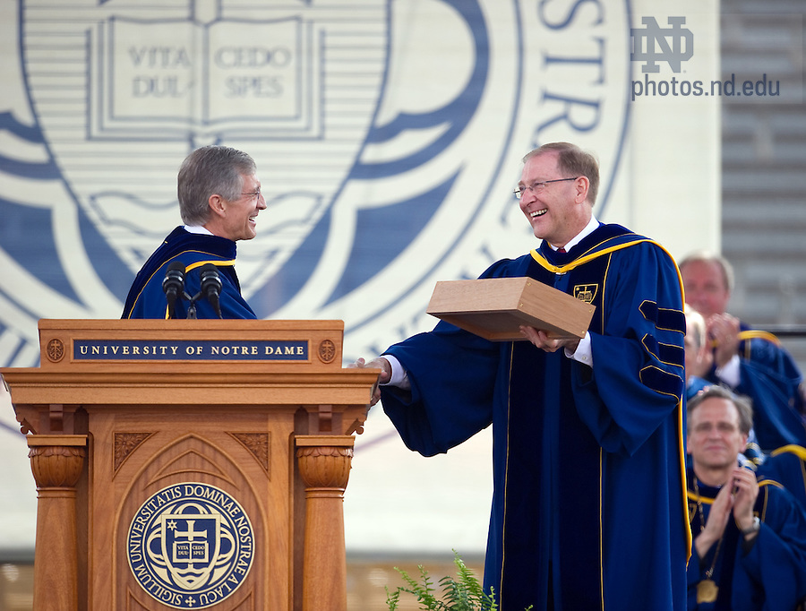 May 22, 2011; Thomas Burish, provost of the University of Notre Dame presents a gift to outgoing registrar Harold Pace at the 2011 Commencement ceremony...Photo by Matt Cashore/University of Notre Dame