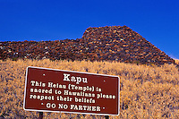 A kapu (off-limits) sign asks visitors to respect Hawaiian beliefs at Puukohola (hill of the whale) Heiau (temple) National Historical Park at Kawaihae on the Big Island of Hawaii's Kohala Coast. It was built of lava rock by King Kamehameha I for hi