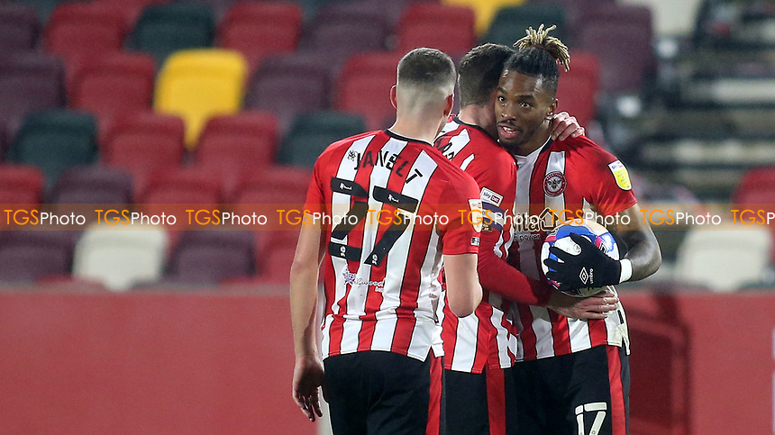 Ivan Toney of Brentford keeps hold of the match ball and celebrates at the final whistle after scoring three goals during Brentford vs Wycombe Wanderers, Sky Bet EFL Championship Football at the Brentford Community Stadium on 30th January 2021
