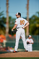 Baltimore Orioles relief pitcher Lucas Long (90) looks in for the sign during a Grapefruit League Spring Training game against the Detroit Tigers on March 3, 2019 at Ed Smith Stadium in Sarasota, Florida.  Baltimore defeated Detroit 7-5.  (Mike Janes/Four Seam Images)