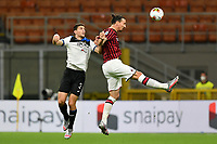 Zlatan Ibrahimovic of AC Milan and Mattia Caldara of Atalanta BC compete for the ball during the Serie A football match between AC Milan and Atalanta BC at stadio Giuseppe Meazza in Milano ( Italy ), July 24th, 2020. Play resumes behind closed doors following the outbreak of the coronavirus disease. <br /> Photo Image Sport / Insidefoto