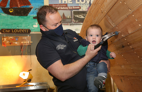 Ross Forde, Club Director, gives a helping hand to his son Jamie at hammering in a nail on the Loveen