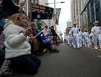 120425-N-DR144-361 PERTH, Australia (April 25, 2012) Residents wave flags as Sailors assigned the Nimitz-class aircraft carrier USS Carl Vinson (CVN 70) march in the Australia and New Zealand Army Corps (ANZAC) Day March through downtown Perth. ANZAC Day is a national day of remembrance in Australia and New Zealand to honor those who died and served in military operations for their countries. Carl Vinson is anchored in Perth, Australia for a port visit. (U.S. Navy photo by Mass Communication Specialist 2nd Class James R. Evans/Released)