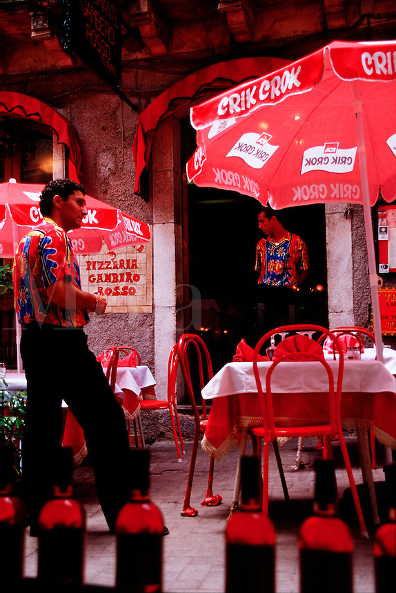 Waiters at a colorful outdoor Italian cafe. Taormina, Sicily, Italy.