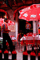 Waiters at a colorful outdoor Italian cafe. Taormina, Sicily, Italy.