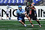 Face-Off Classic:  Midfielder Ryan Creighton #33 of the North Carolina Tar Heels defends Attackmen Mike Grossman # 8 of the Princeton Tigers during the Princeton v North Carolina mens lacrosse game at M&T Bank Stadium on March 10, 2012 in Baltimore, Maryland.(Ryan Lasek/Eclipse Sportswire)