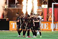 ATLANTA, GA - APRIL 24: Atlanta United celebrate taking the lead on a goal in the 65th minute during a game between Chicago Fire FC and Atlanta United FC at Mercedes-Benz Stadium on April 24, 2021 in Atlanta, Georgia.
