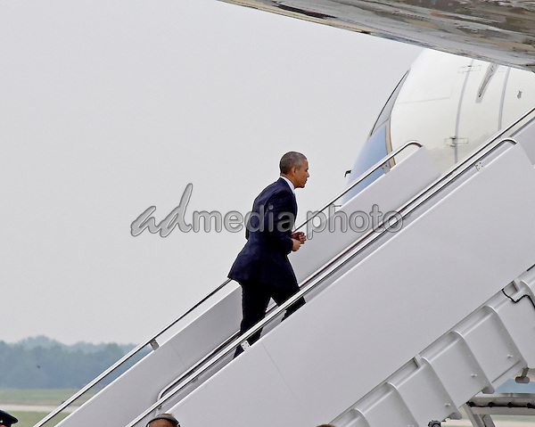 United States President Barack Obama boards Air Force One for a flight to La Crosse, Wisconsin to deliver remarks on the economy at  the University of Wisconsin on Thursday, July 2, 2015. Photo Credit: Ron Sachs/CNP/AdMedia