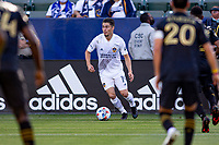 CARSON, CA - MAY 8: Jorge Villafana #19 of the Los Angeles Galaxy turns and moves with the ball during a game between Los Angeles FC and Los Angeles Galaxy at Dignity Health Sports Park on May 8, 2021 in Carson, California.