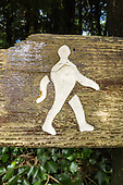 Wye Valley, United Kingdom. Wooden trekking sign showing a picture of a larger man.
