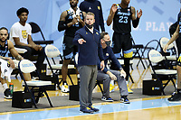 CHAPEL HILL, NC - FEBRUARY 24: Head coach Steve Wojciechowski of Marquette watches from the bench during a game between Marquette and North Carolina at Dean E. Smith Center on February 24, 2021 in Chapel Hill, North Carolina.