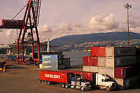 container shipping at Centerm Container Terminal. Transportation, industry, crane, ship, freighter, harbor, trade, port. Vancouver British Columbia Canada inner harbour.
