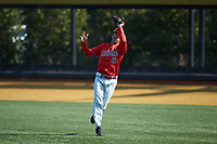 Radford Highlanders right fielder Richard De la Cruz (12) makes a running catch during the game against the Quinnipiac Bobcats at David F. Couch Ballpark on March 4, 2017 in Winston-Salem, North Carolina. The Highlanders defeated the Bobcats 4-0. (Brian Westerholt/Four Seam Images)