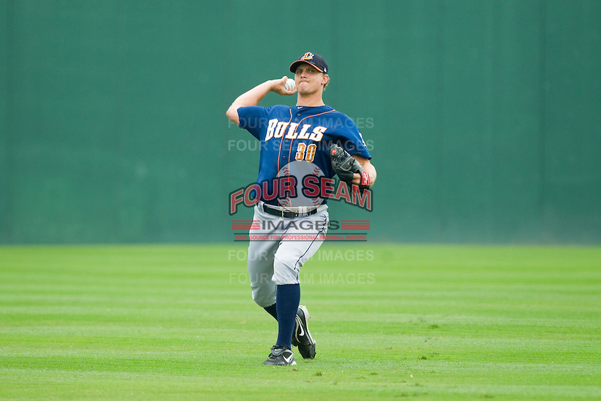 Durham Bulls starting pitcher J.D. Martin (30) warms up in the outfield prior to the game against the Charlotte Knights at Knights Stadium on August 18, 2013 in Fort Mill, South Carolina.  The Bulls defeated the Knights 8-5 in Game One of a double-header.  (Brian Westerholt/Four Seam Images)