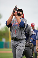 Lehigh Valley IronPigs relief pitcher Pedro Beato (44) looks skyward as he walks off the field during a game against the Syracuse Chiefs on May 20, 2018 at NBT Bank Stadium in Syracuse, New York.  Lehigh Valley defeated Syracuse 5-2.  (Mike Janes/Four Seam Images)